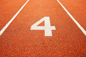 Number four on running track — Stock Photo