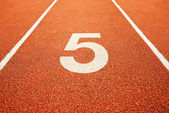 Number five on running track — Stock Photo