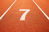 Number seven on running track — Stock Photo