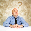 Stock Photo: Businessmquestioning