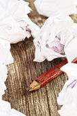 Pencil and crumpled paper — Stock Photo
