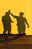 Construction workers shadows — Stock Photo