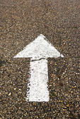 White arrow on the road — Stock Photo