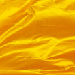 Golden waving flag — Stock Photo