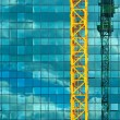 Construction crane and office building — Stock Photo