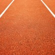 Athletics all weather running track — Stock Photo