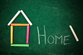 Home on chalkboard — Stock Photo