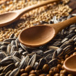 Spoons and grains — Stock Photo