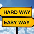 Hard way or easy way, opposite signs — Stock Photo #30401223