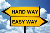 Hard way or easy way, opposite signs — Stock Photo