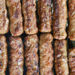 Grilled meat on the abrbeque plate — Stock Photo #30552567