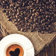 Coffee beans and coffe cup — Stock Photo