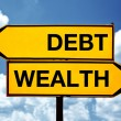 Debt or wealth, opposite signs — Stock Photo