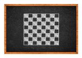 Chess board drawing on a black chalkboard — Stock Photo