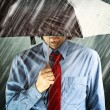 Businessman with umbrella in storm — Stock Photo #31118625