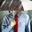 Businessmwith umbrellin storm — Stock Photo #31118625