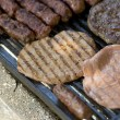Grilled meat on the barbeque plate — Stock Photo #31120109