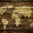 Stock Photo: World map on wood background