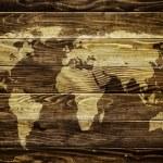 World map on wood background — Stock Photo #31500641