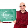 Man with euro sign on a green chalkboard — Stock Photo