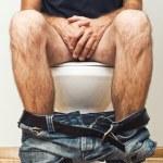 Man sitting on toilet — Stock Photo #32149811