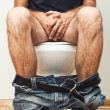 Msitting on toilet — Stock Photo #32149811