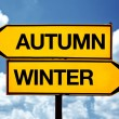 Autumn or winter, opposite signs — Stock Photo