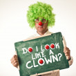 Clown with chalkboard — Stock Photo