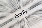 Word deadly in the book — Stock Photo