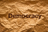 Democracy on Crumpled paper — Stock Photo