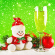 Christmas balls, glass of wine and wool snowman — Stock Photo