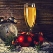 Christmas balls and vintage clock with glass of champagne — Stock Photo #33302691