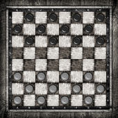 Travelling draughts or checkers on playing field — Stock Photo