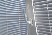 Venetian blinds on window — Stock Photo