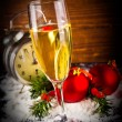 Christmas balls and vintage clock with glass of champagne — Stock Photo