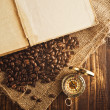 Coffee beans and compass — Stock Photo