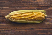 Ear of corn on wooden background — Foto Stock