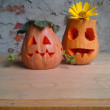 Funny halloween pumpkins on wooden table. Autumn harvesting season. — Stock Photo