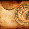 Navigation compass on Grunge old paper texture — Stock Photo