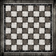 Old wooden chess board — Stock Photo