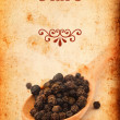 Pepper spice on Grunge old paper texture — Stock Photo