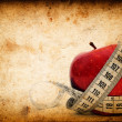 Red apple on Grunge old paper texture — Stock Photo
