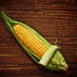 ear of corn opening — Stock Photo