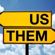 Us or them, opposite signs — Stock Photo