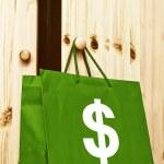 Shopping bag with dollar symbol — Stock Photo