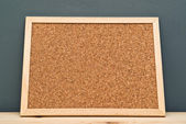 Cork memory board on wooden cabinet — Stock Photo