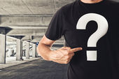 Man in black t-shirt with question mark — Stock Photo