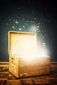Open magical Wooden crate box on the floor — Stock Photo