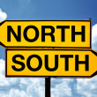 North or south, opposite signs — Stock Photo