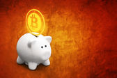 Saving bitcoins in piggy coin bank — Stock Photo